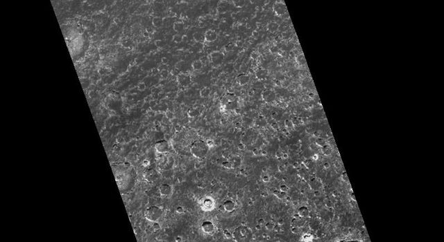 Images from NASA's Galileo spacecraft provide new insights into this region near Callisto's south pole. This two frame mosaic shows a heavily cratered surface with smooth plains in the areas between craters.
