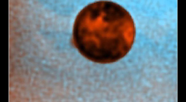 NASA's Hubble Space Telescope has snapped a picture of a 400-km-high (250-mile-high) plume of gas and dust from a volcanic eruption on Io, Jupiter's large innermost moon.