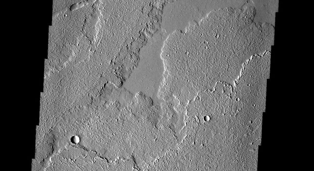 These lava flows and collapse features are part of Ascraeus Mons on Mars, taken by NASA's Mars 2001 Odyssey spacecraft.