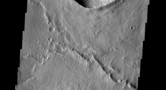 The two craters in this image are located in Zephyria Planum on Mars. The crater floors appear to be modified only by deposits of fine materials. This image was taken by NASA's Mars 2001 Odyssey spacecraft.