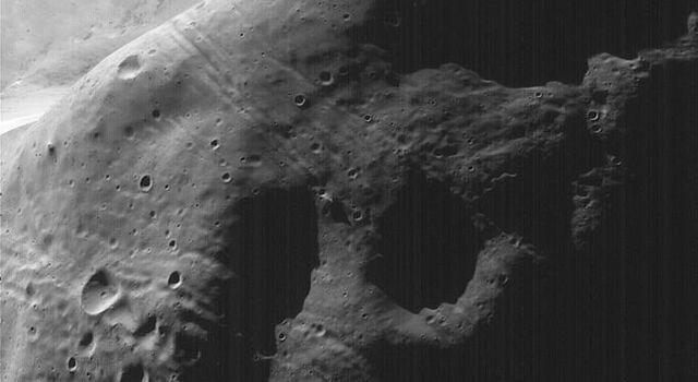 This image acquired on August 19, 1998 by NASA's Mars Global Surveyor shows Phobos, the inner and larger of the two moons of Mars. A close-up of the largest crater on Phobos, Stickney, shows ejecta blocks from the impact that formed Stickney.