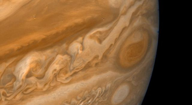 This color composite made from NASA's Voyager 2 shows the Great Red Spot during the late Jovian afternoon. North of the Red Spot lies a curious darker section of the South Equatorial Belt (SEB), the belt in which the Red Spot is located.
