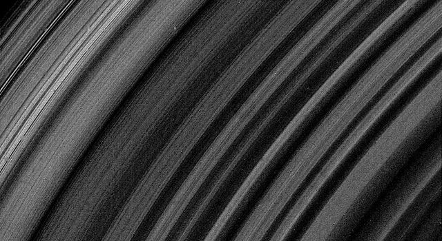 This photograph captured by NASA's Voyager 2 photograph of the lit face of Saturn's B-ring was obtained Aug. 25, 1980. It shows the ring structure broken up into about 10 times more ringlets than had been previously suspected.