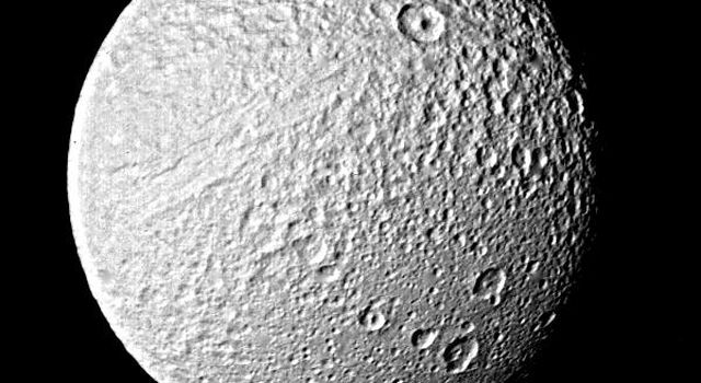 This photograph taken on Aug. 26, 1981,  from NASA's Voyager 2 of Tethys shows objects about 5 kilometers (3 miles) in size and is one of the best images of the Saturnian satellite returned by the spacecraft or its predecessor, Voyager 1.