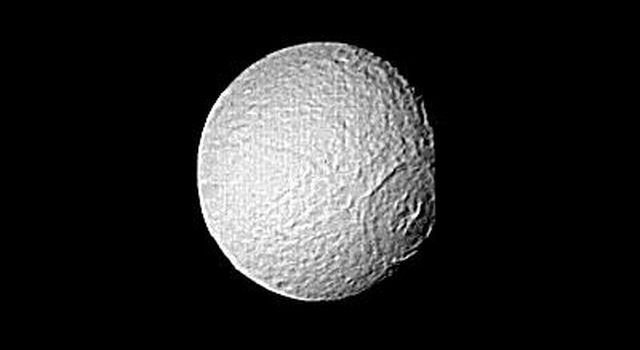 Special processing has brought out surface detail in NASA's Voyager 2 image focusing on the large crater on Tethys. The spacecraft took this photograph Aug. 25, 1981, when it was 826,000 kilometers (513,000 miles) from the icy moon of Saturn
