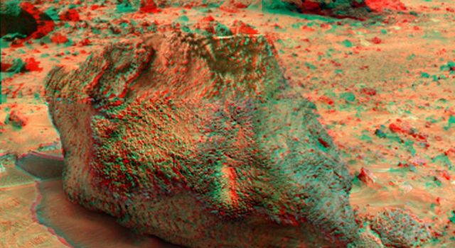 'Yogi' is a meter-size rock about 5 meters northwest of NASA's Mars Pathfinder lander and was the second rock visited by the Sojourner Rover's alpha proton X-ray spectrometer (APXS) instrument. 3D glasses are necessary to identify surface detail.