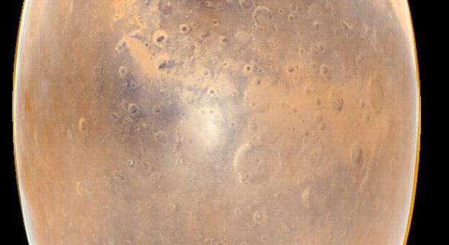 This image from NASA's Mars Global Surveyor acquired in February 1998, shows the large, dark region near the top-center of the picture of Sinus Meridiani. The circular feature at the upper right is the impact basin, Schiaparelli.