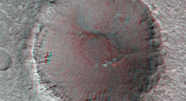 On its 256th orbit of Mars, the camera on-board NASA's Mars Global Surveyor spacecraft successfully observed the vicinity of the Mars Pathfinder landing site. 3D glasses are necessary to identify surface detail.
