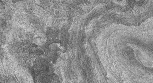 NASA's Mars Global Surveyor acquired this image on April 11, 1998. Shown here are layered materials in the walls and on the floors of the enormous Valles Marineris system.