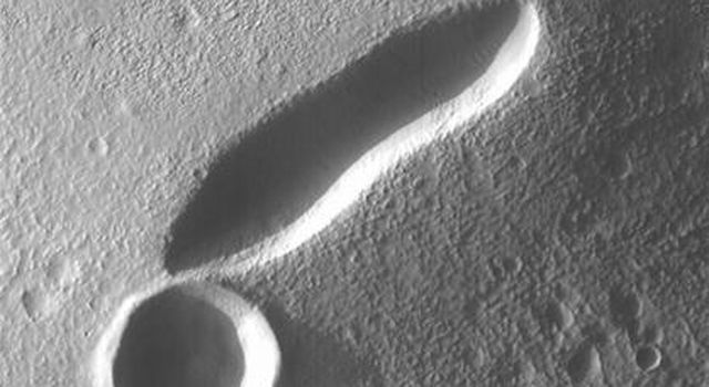 This image taken on August 22, 1998 by NASA's Mars Global Surveyor shows a small volcano is located in the Tempe-Mareotis Fossae region of Tempe Terra on Mars.