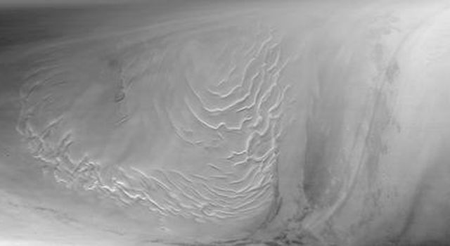 This image taken on Sept 12, 1998 by NASA's Mars Global Surveyor shows the north polar layered deposits, a terrain believed composed of ice and dust deposited over millions of years.