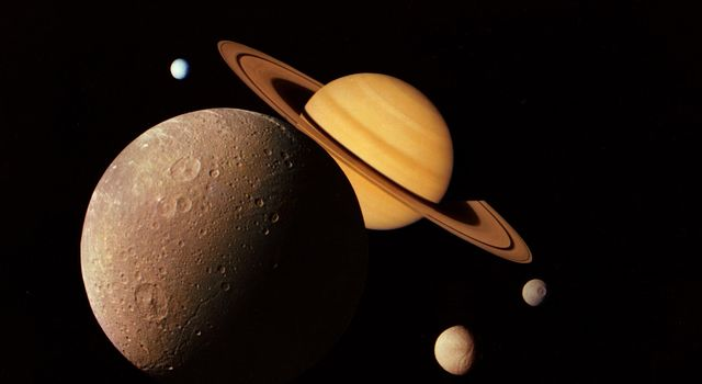 This montage of images of the Saturnian system was prepared from an assemblage of images taken by NASA's Voyager 1 spacecraft during its Saturn encounter in November 1980.