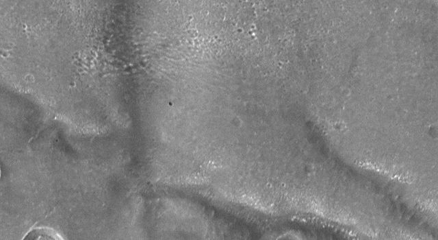 NASA's Mars Global Surveyor shows a portion of Corasis Fossae valleys. These subdued valleys and pits show structural control. The pattern of pitting suggests removal of subsurface support may have played an important role in valley formation.