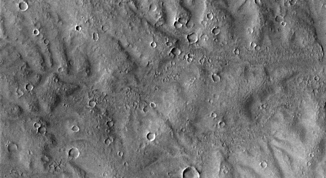 NASA's Mars Global Surveyor shows a portion of dissected terrain southeast of Parana Valles on Mars.