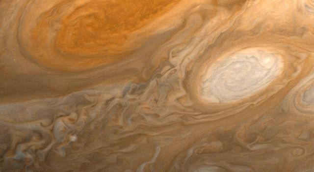 This photo of Jupiter was taken by NASA's Voyager 1 on the evening of March 1, 1979, from a distance of 2.7 million miles (4.3 million kilometers). The photo shows Jupiter's Great Red Spot (top) and one of the white ovals.
