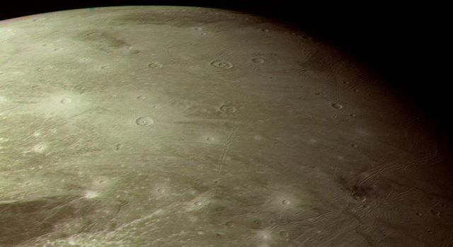 This color picture as acquired by NASA's Voyager 1 during its approach to Ganymede on Monday afternoon Mar. 5, 1979. This picture is of a region in the northern hemisphere near the terminator.