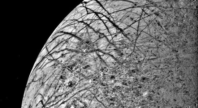 The first close look ever obtained of Jupiter's satellite, Europa, was taken July 9, 1979, by NASA's Voyager 2 as the spacecraft approached the planet.