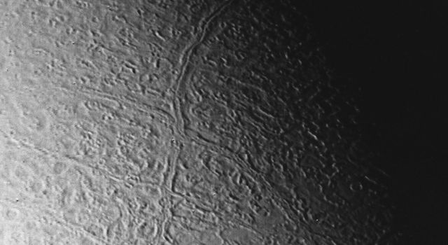 This image of Triton was taken on Aug. 25 1989 by NASA's Voyager 2. The image was received at JPL four hours later at about 4:20 a.m. The smallest detail that can be seen is about 2.5 kilometers (1.5 miles) across.