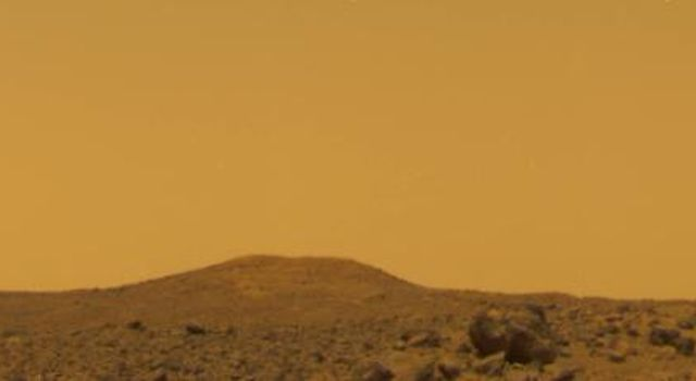 This image from NASA's Mars Pathfinder was taken near local noon on Sol 10, 1997. The color of the Pathfinder's landing site is yellowish brown with only subtle variations.