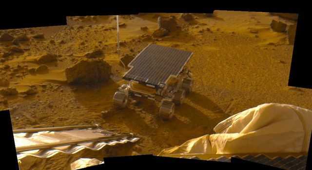 This mosaic was acquired during the late afternoon (note the long shadows) on Sol 2, 1997 as part of the predeploy 'insurance panorama' and shows the newly deployed rover NASA's Mars Pathfinder Sojourner sitting on the Martian surface.