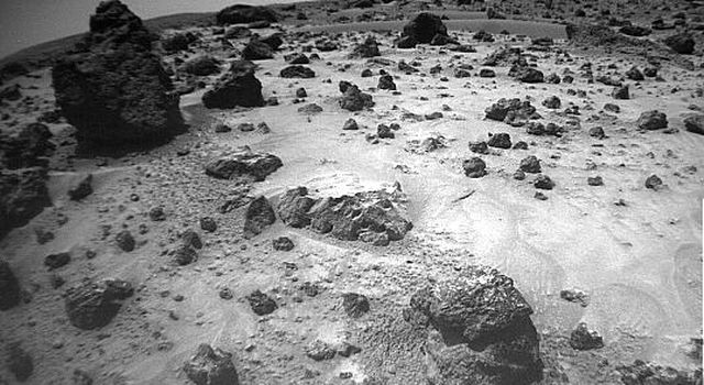 NASA's Mars Pathfinder's rover Sojourner imaged this area of Martian terrain on Sol 26, 1997. The large rock dubbed 'Pooh Bear' is at far left. 'Mermaid Dune' is the smooth area stretching horizontally across the top quarter of the image.