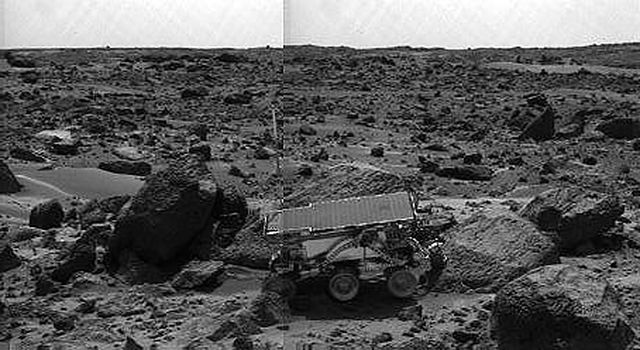 NASA's Sojourner rover's Alpha Proton X-ray Spectrometer (APXS) is shown deployed against the rock 'Moe' on the afternoon of Sol 64 (September 7, 1997).