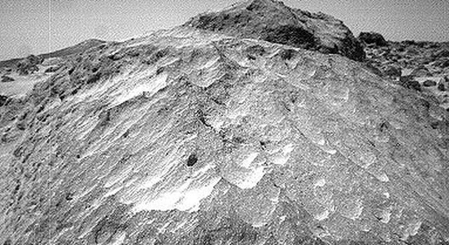 A close-up view of the rock 'Moe' in the 'Rock Garden' at the Pathfinder landing site. Moe is a meter-size boulder that, as seen by NASA's Sojourner, has a relatively smooth yet pitted texture upon close examination. Sol 1 began on July 4, 1997.