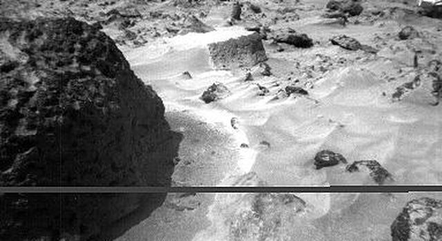The rock 'Stimpy' is seen in this close-up image taken by NASA's Sojourner rover's right front camera on Sol 70 (September 13). Detailed texture on the rock, such as pits and flutes, are clearly visible. Sol 1 began on July 4, 1997.