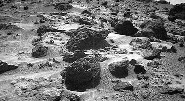 This left image of a stereo image pair, taken on Sol 72 (September 15) from NASA's Sojourner rover's front cameras, shows areas of the Pathfinder landing site never before seen. The large rock on the right is 'Chimp.' Sol 1 began on July 4, 1997.
