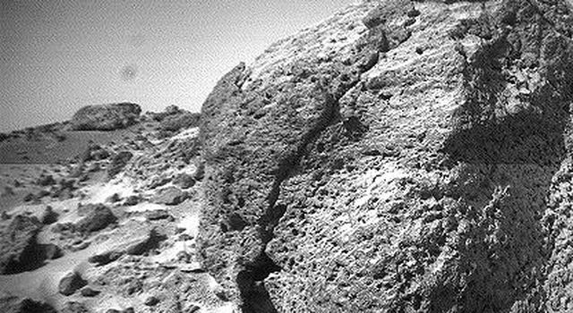 This view of the rock 'Chimp' was acquired by NASA's Sojourner rover's left front camera on Sol 74 (September 17). A large crack, oriented from lower left to upper right, is visible in the rock. Sol 1 began on July 4, 1997.