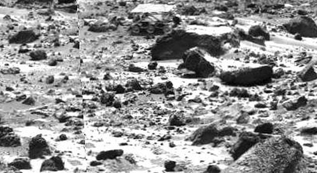 This left image of a stereo image pair taken on the afternoon of Sol 74 (September 17) shows NASA's Sojourner rover behind the rock 'Chimp.' Sojourner is now a record 12.3 m from the lander. Sol 1 began on July 4, 1997.