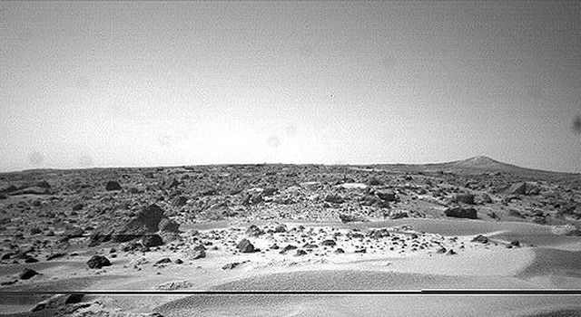 This image was taken by NASA's Sojourner rover in the area behind the 'Rock Garden' at the Pathfinder landing site and gives a view of the Martian surface not seen from the lander. Sol 1 began on July 4, 1997.