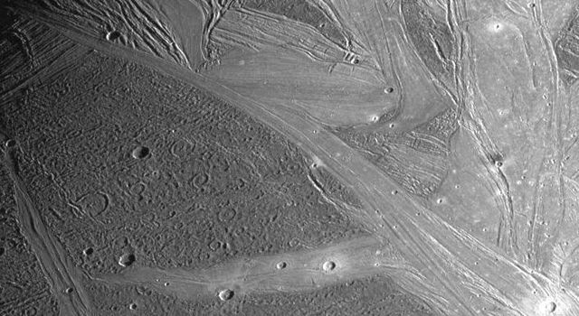 View of the Marius Regio and Nippur Sulcus area of Jupiter's moon, Ganymede showing the dark and bright grooved terrain which is typical of this satellite. Image taken by the Solid State Imaging (SSI) system on NASA's Galileo spacecraft.