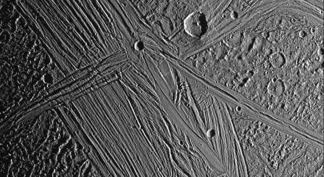 View of the Tiamat Sulcus region on Jupiter's moon, Ganymede, imaged just after local sunrise. The illumination from such a low sun angle highlights the grooved topography of Tiamat. Image from NASA's Galileo spacecraft.