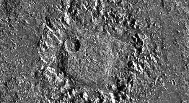 This image captured by NASA's Galileo spacecraft shows crater Neith, an unusual impact structure about 160 km (100 miles) in diameter, situated on Jupiter's largest satellite, Ganymede.