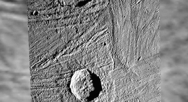 This image shows a Galileo high-resolution mosaic of craters Gula (top) and Achelous (bottom), projected on a lower-resolution background of image data that were obtained in the late 70s by the NASA Voyager spacecraft.