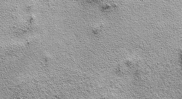 NASA's Mars Global Surveyor shows a common, rough and bumpy texture on the northern plains of Mars.