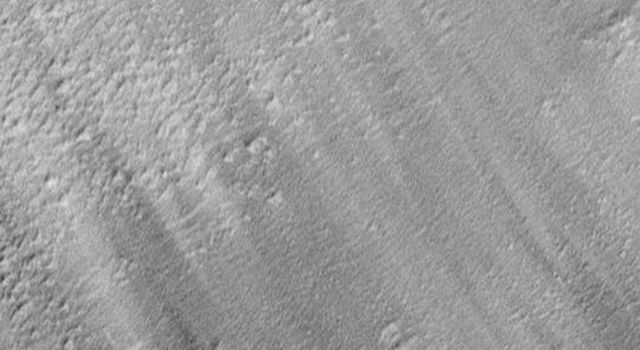 NASA's Mars Global Surveyor shows pedestal craters and wind streaks in South Medusae Fossae.