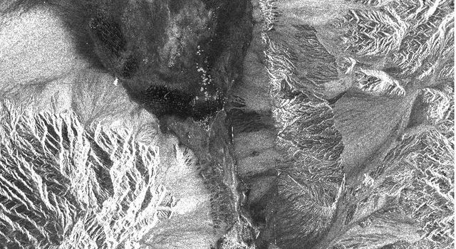 This image from NASA's Spaceborne Imaging Radar-C/X-band Synthetic Aperture Radar shows the Furnace Creek alluvial fan and Furnace Creek Ranch at the far right, and the sand dunes near Stove Pipe Wells.