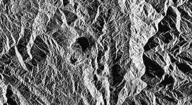 This is a radar image of a little known volcano in northern Colombia. The image was acquired on orbit 80 of space shuttle Endeavour on April 14, 1994, by NASA's Spaceborne Imaging Radar C/X-Band Synthetic Aperture Radar.