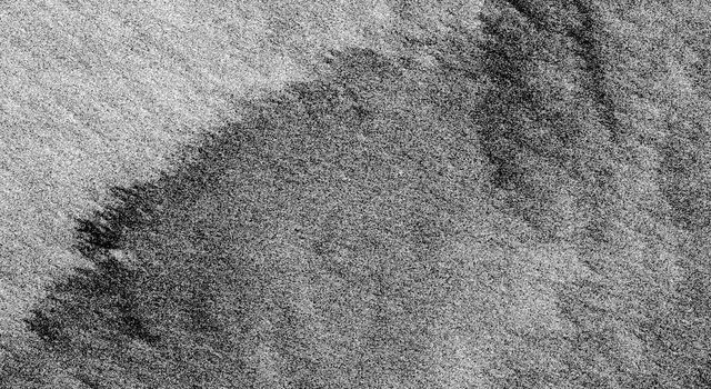 This is an X-band image from NASA's Spaceborne Imaging Radar C/X-Band Synthetic Aperture Radar of an oil slick experiment conducted in the North Sea, Germany. The image is centered at 54.58 degrees north latitude and 7.48 degrees east longitude.