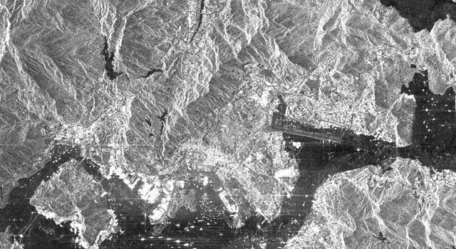 This is an X-SAR image from NASA's Spaceborne Imaging Radar C/X-Band Synthetic Aperture Radar spanning an area of the island of Hong Kong, the Kowloon Peninsula and the new territories in southern China.