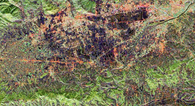 This radar image from NASA's Spaceborne Imaging Radar-C/X-band Synthetic Aperture Radar shows land use patterns in and around the city of Florence, Italy. Florence is situated on a plain in the Chianti Hill region of Central Italy.
