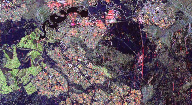 Australia's capital city, Canberra, is shown in the center of this spaceborne radar image from NASA's Spaceborne Imaging Radar C/X-Band Synthetic Aperture Radar. Images like this can help urban planners assess land use patterns.