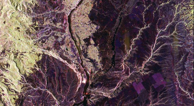 This spaceborne radar image from NASA's Spaceborne Imaging Radar C/X-Band Synthetic Aperture Radar shows a segment of the Columbia River as it passes through the area of Wenatchee, Washington, east of Seattle.