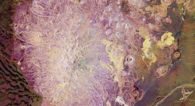 This spaceborne radar image from NASA's Spaceborne Imaging Radar C/X-Band Synthetic Aperture Radar shows the Pinacate Volcanic Field in the state of Sonora, Mexico, southeast of Yuma, Arizona. The United States/Mexico border is evident.