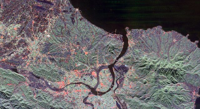 The northern end of the island country of Taiwan, including the capital city of Taipei, is shown in this spaceborne radar image from NASA's Spaceborne Imaging Radar C/X-Band Synthetic Aperture Radar. Taipei is the bright blue and red area.