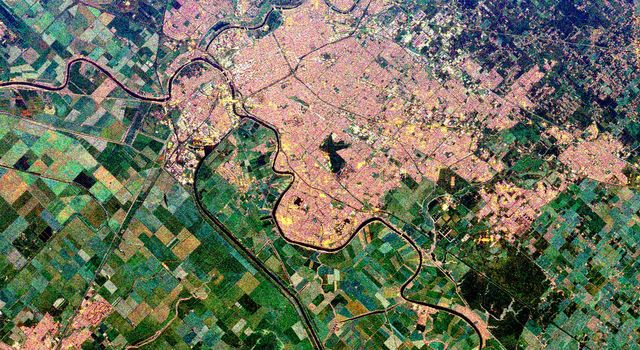 This is a spaceborne radar image from NASA's Spaceborne Imaging Radar C/X-Band Synthetic Aperture Radar of the city of Sacramento, the capital of California. Urban areas appear pink and the surrounding agricultural areas are green and blue.