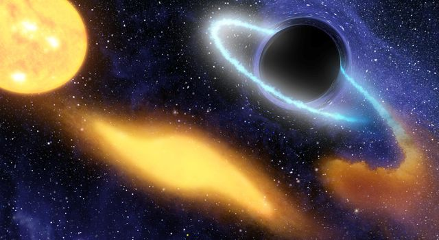 This artist's concept shows a supermassive black hole at the center of a remote galaxy digesting the remnants of a star.