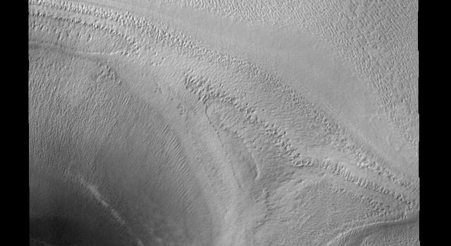 This image shows half of a crater on the polar cap of Mars as seen by NASA's 2001 Mars Odyssey spacecraft.